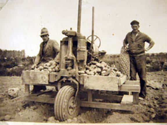 George Green and Archie Oliver, employees of Walter Mark Oakley, planting potatoes with a Farmhall F12 Tractor, 1933.
