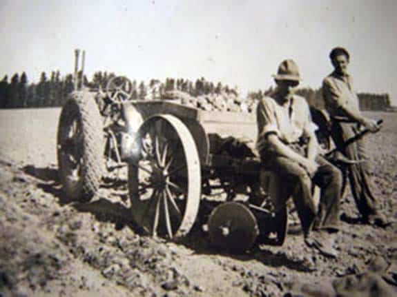 George Green and Archie Oliver planting potatoes with a two row planter built by Walker Mark Oakley where he joined two single row planted together, 1935.